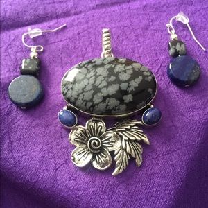 Black obsidian stone with blue lapis accents